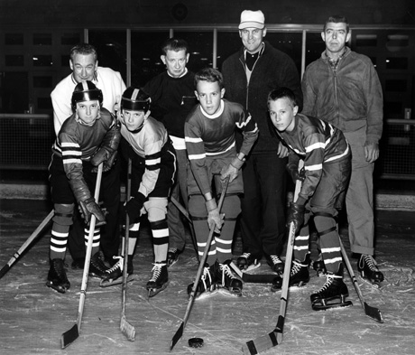 From the collections of the St. Louis Mercantile Library at the University of Missouri-St. Louis This photo originally was published in the St. Louis Globe-Democrat on Nov. 7, 1961. It shows players and coaches from the very first youth hockey league in St. Louis, at Steinberg Rink in Forest Park. They are, first row, from left: John Burger Jr., Ed Signaigo, Terry McKenna and Scott Christofferson; second row, from left: Bouncer Taylor, Shrimp McPherson, Eddie Olson and George Milligan. In the photo caption so long ago, the Globe had the wrong first name for McKenna. Perhaps the photographer heard it wrong or wrote it wrong, or maybe the copy editor read it wrong. Whatever the case, almost 52 years later, this serves as a correction.